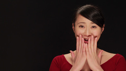 Young Asian Woman Surprised Reaction Face Portrait, Black Background stock footage