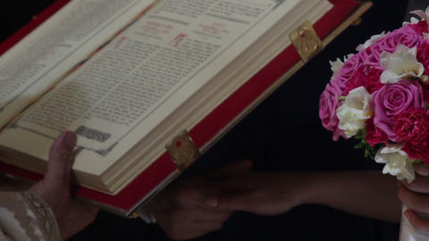 Priest reads from the holy book of religious service 04 Footage