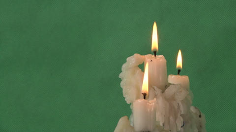 Candles On A Green Background stock footage