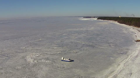 Hovercraft Moves On The Frozen Lake, Aerial View stock footage