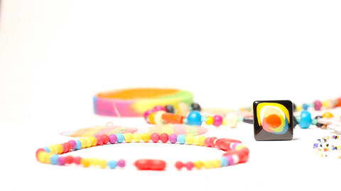 Colorful Plastic Jewellery 01 dolly right Stock Video Footage