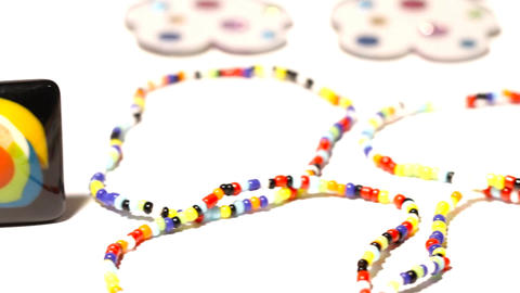 Colorful Plastic Jewellery 03 dolly left Stock Video Footage