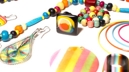 Colorful Plastic Jewellery 07 pan right Stock Video Footage