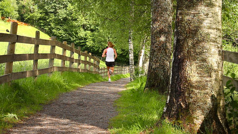 Runner On Nature Path 01 Footage