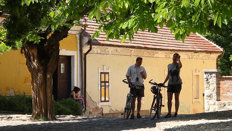 Old European Village 13 cyclists Stock Video Footage