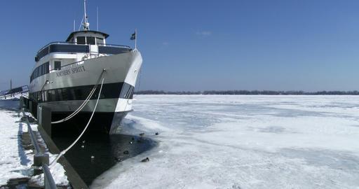 Boat docked on frozen lake Ontario Footage
