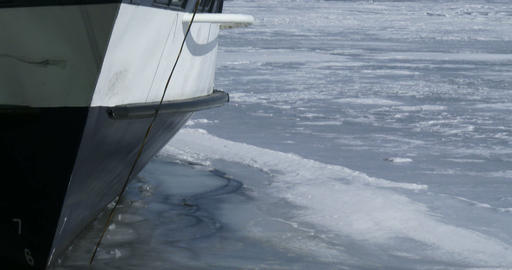 Detail of the bow of a boat docked on frozen lake Ontario Footage