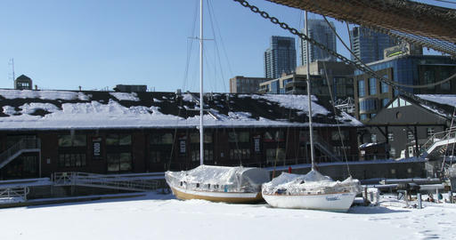 Sailing boats docked on frozen water in Toronto Footage