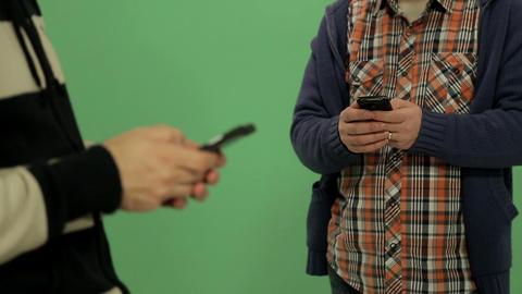 Two Men Using Smartphone - Rack Focus stock footage