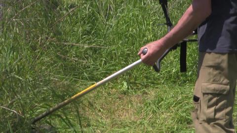Gardener mowing grass 09 Footage