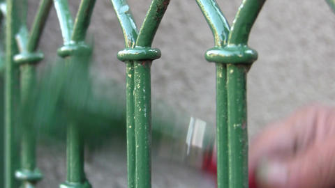 Painter Painted Metal Grille With Green Paint 01 stock footage
