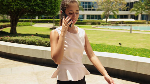 Happy Business Woman Talking On Mobile Phone Walking Footage