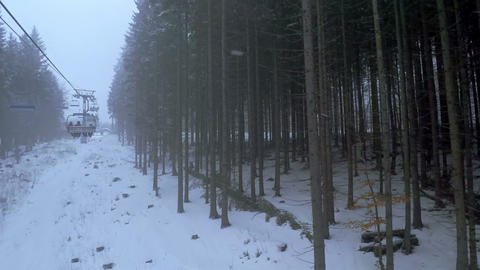 Skilift in the Forest with Snowfall Footage