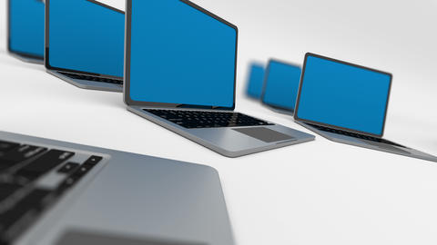 3d render of a lot of laptops in a row. Loopable. Depth of field Animation