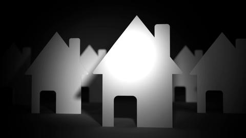 Close up of paper houses on black background Animation