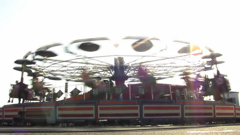 Rotating carousel in an amusement park 11 Footage