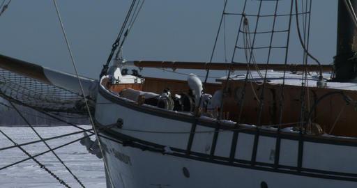 Old vessel docked on frozen lake Ontario Footage