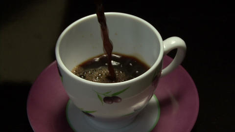 coffee drop into the Cup slow motion Live Action