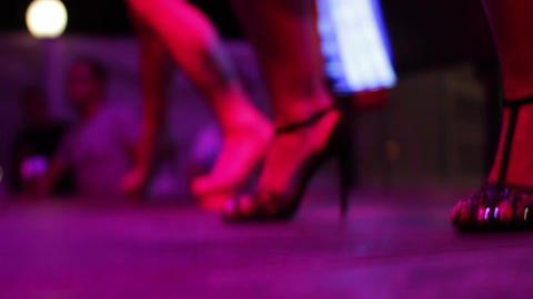 A closeup of the shoes of club dancers on the stage of summer nightclub Footage