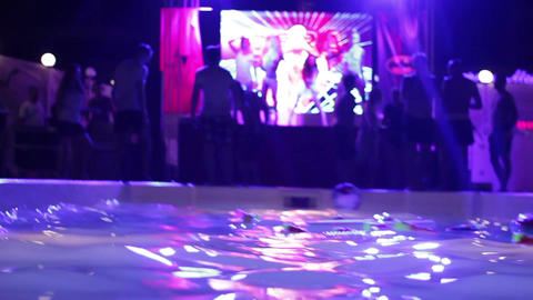 beautiful and young people dancing at a party near the pool Footage