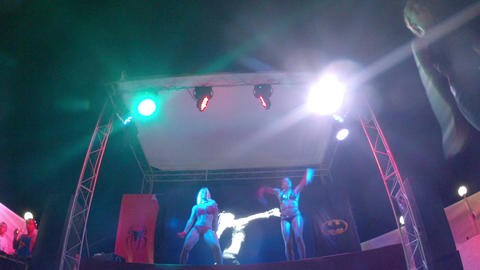 Two PJ dancers on the stage of summer nightclub Live Action