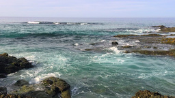 Shallow Shoreline Ocean Water Surrounds A Rocky Reef stock footage