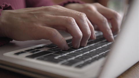 Woman Typing On Laptop stock footage