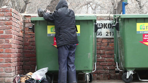 Man Looking In A Trash Food stock footage
