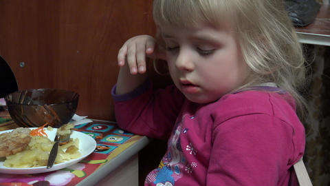 Little Girl Fell Asleep at the Table Eating Potato. 4k Ultra HD Footage
