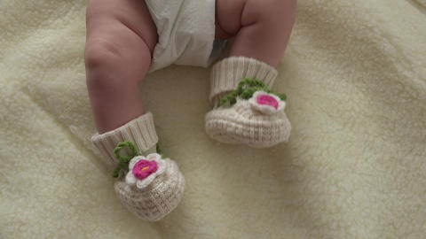 Baby Moves by Feet in Funny Socks. 4k Ultra HD Footage