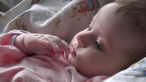 Newborn Girl Laying on a Blanket and Playing with her Hand. 4k UHD Footage