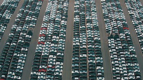 Flying Above Storage Parking Lot Of New Unsold Cars stock footage