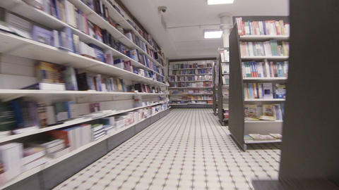 Shelves with books in a bookstore Footage