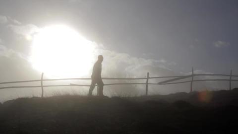 Person walking through mist 02 Footage