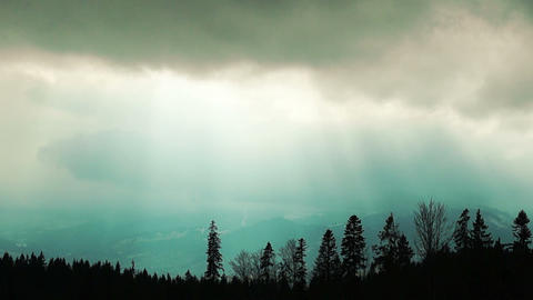 Dark Storm Clouds with the Sun's Rays over the Carpathian Mountains Footage