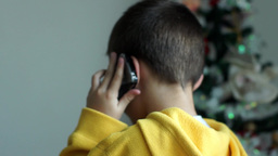 Child talk with cell phone Footage