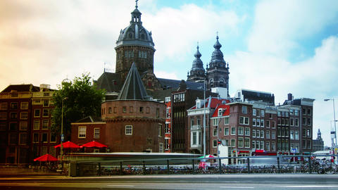 Rush hour in Amsterdam with Church of St Nicholas in background.time lapse,4k Footage
