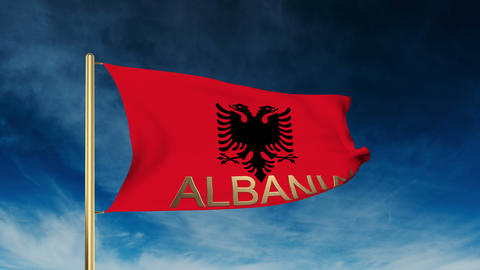 Albania flag slider style with title. Waving in the wind with cloud background a Animation