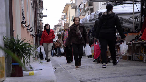 Pedestrian traffic in the clothing market 7 Stock Video Footage