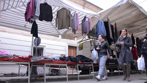 Pedestrian traffic in the clothing market 5 Stock Video Footage
