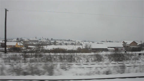 Snowy city seen from the train 1 Stock Video Footage