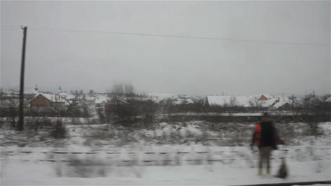 Snowy city seen from the train 1 Footage