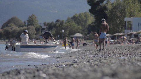 People and boats on the beach Stock Video Footage