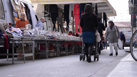 Pedestrian traffic in the clothing market 4 Stock Video Footage