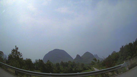 (Timelapse) Guilin China Driving Through Mountains Stock Video Footage