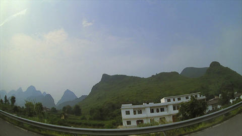 (Timelapse) Guilin China Driving Through Mountains Footage