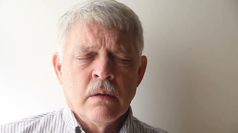 man sneezes Stock Video Footage