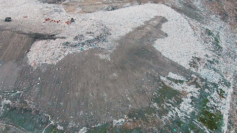 Aerial Shot Landfill with Working Trucks and Tractor Footage
