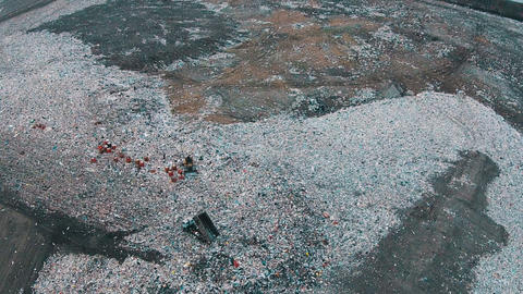 Aerial Shot Landfill with Working Trucks and Tractor Stock Video Footage