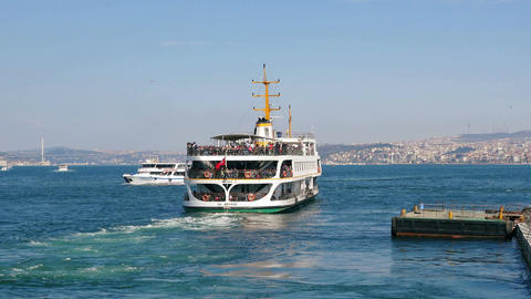 Bosphorus sightseeing tour ship leaving from old Istanbul Footage